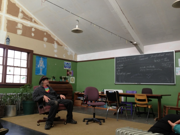 In the Farm school talking with the Principal and Janitor, Peter Kindfield.