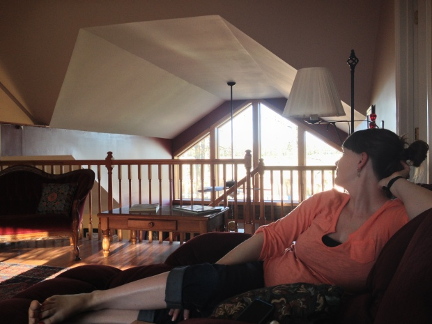 """Amy relaxing in our """"rustic"""" accommodations."""