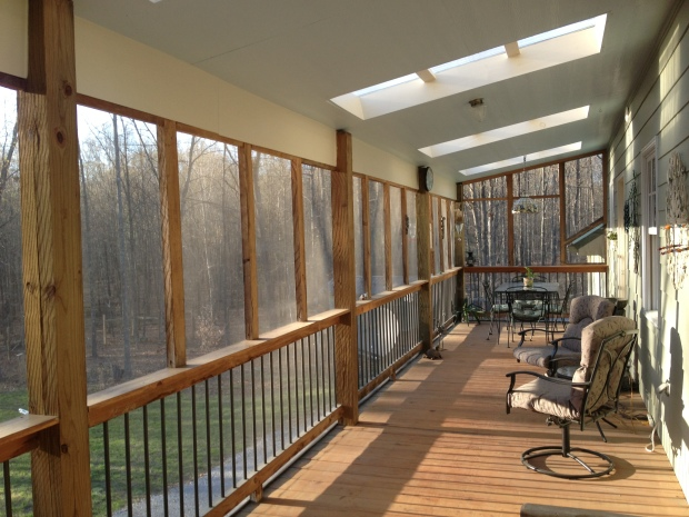 The grand porch overlooking the woods at Phil & Mary's.