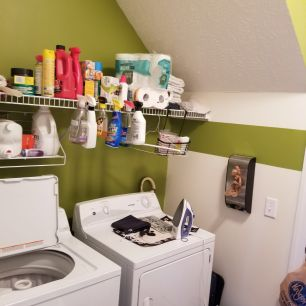 Before: messy laundry room
